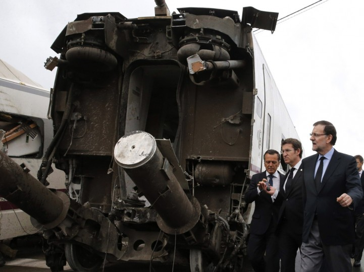 Spanish Prime Minister Mariano Rajoy (R) and Galicia's regional President Alberto Nunez Feijoo (2nd R) visit the site of a train accident near the city of Santiago de Compostela on July 25, 2013. A train hurtled off the tracks on July 24 in northwest Spain killing at least 77 passengers and injuring more than 140, an official said today, the country's deadliest rail disaster in more than 40 years. (Lavandeira Jr/Getty images)