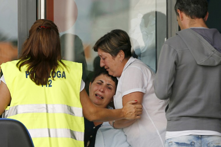 Relatives of the victims of a train accident react outside the Cersia building, where they are attended by psychologists from the Red Cross in Santiago de Compostela on July 25, 2013. A train hurtled off the tracks on July 24 in northwest Spain killing at least 78 passengers and injuring more than 140, an official said today, the country's deadliest rail disaster in more than 40 years.(Cesar Manso/Getty images)