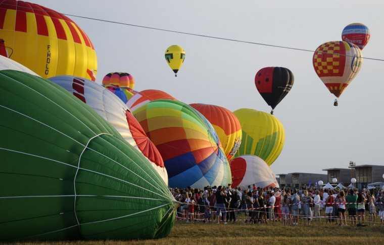 "A hot air-balloons flies over Chambley-Bussieres, eastern France on July 27, 2013 as part of the yearly event ""Lorraine Mondial Air Ballons"", an international air-balloon meeting. Around 363 to 373 air-balloons took part to the take-off. (Jean-Christophe Verhaegen/Getty Images)"