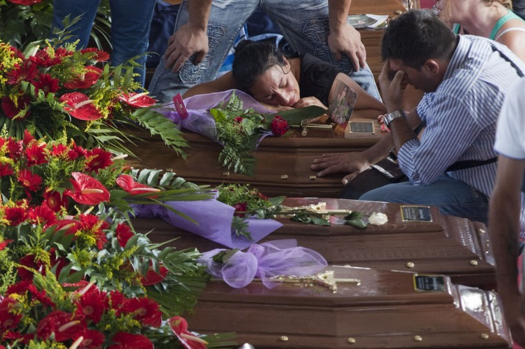 Relatives mourn victims of a bus crash in Moterusciello, southern Italy, during a mass funeral for the 38 people killed in Italy when a coach plunged off a viaduct near Naples. The coach, carrying 48 people including children, rammed several cars after failing to break on a bend, smashing through a crash barrier and off the viaduct to plunge 30 metres (98 feet) down. Prosecutors have launched an investigation into possible manslaughter over the accident, the worst such crash in western Europe in the last decade. (Carlo Hermann/Getty Images)
