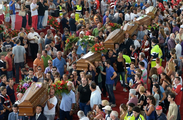 Coffins are carried by relatives after a mass funeral for the 38 people killed in Italy when a coach plunged off a viaduct near Naples in Moteruscello, southern Italy. The coach, carrying 48 people including children, rammed several cars after failing to break on a bend, smashing through a crash barrier and off the viaduct to plunge 30 metres (98 feet) down. Prosecutors have launched an investigation into possible manslaughter over the accident, the worst such crash in western Europe in the last decade. (Alberto Pizzoli/Getty Images)
