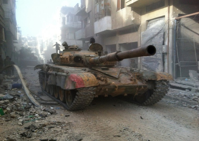 A Syrian government forces' tank rolls in the Khaldiyeh district of Syria's central city of Homs. The Syrian government announced on July 29, the capture of Khaldiyeh, a key rebel district in Homs, Syria's third city and a symbol of the revolt against President Bashar al-Assad. (Getty Images)