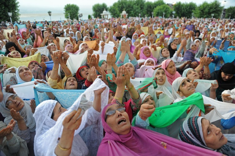 Kashmiri Muslim women prays as an unseen custodian displays a holy relic, believed to be a hair from Prophet Muhammad's beard, during special prayers to observe the Martyr Day of Hazrat Ali, cousin of Prophet Muhammad, at the Hazratbal Shrine in Srinagar. Hazrat Ali was martyred on the 21st day of the holy month of Ramadan some 1,400 years ago. Muslims all over the world are supposed to fast from dawn to dusk during the month of Ramadan. (Rouf Bhat/Getty Images)