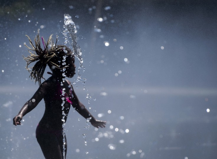 A girl plays in a fountain on the banks of the Manzanares river in Madrid. (Dani Pozo/Getty Images)