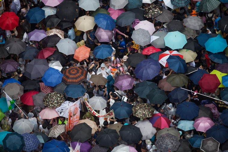 Thousands of protesters with umbrellas attend the march on July 1, 2013 in Hong Kong. Thousands of protesters march calling for universal suffrage and chanting slogans against Hong Kong Chief Executive C Y Leung when Typhoon Signal No. 3 is hoisted. (Lam Yik Fei/Getty Images)