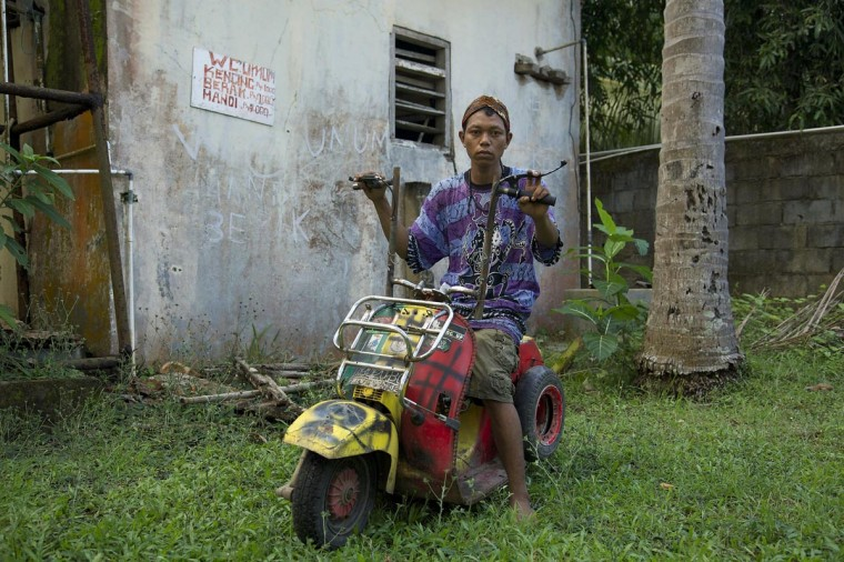 Bujir sits in his extreme vespa modification on June 30, 2013 in Cibeureum, about 100 km west of Jakarta, Indonesia. (Ed Wray/Getty Images)