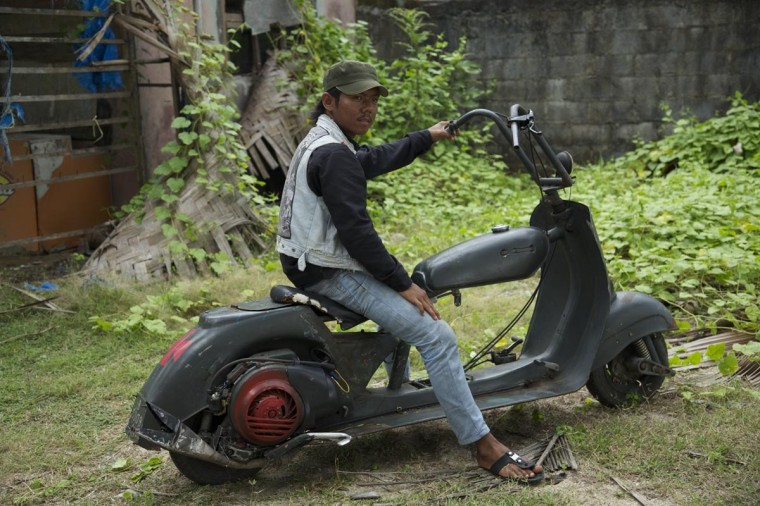Imam sits in his extreme vespa modification during a scooter festival on June 30, 2013 in Cibeureum, about 100 km west of Jakarta, Indonesia. (Ed Wray/Getty Images)