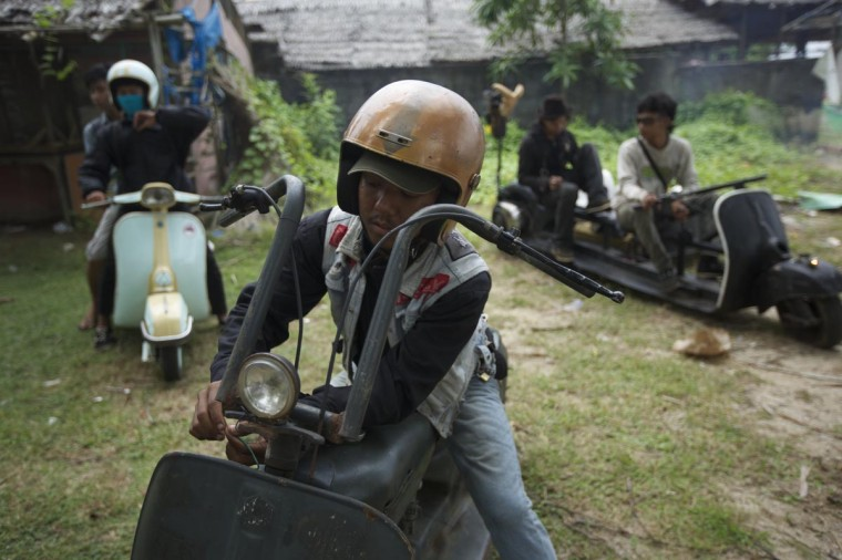 Vespa enthusiasts prepare to return home on their extremely modified vespas after a scooter festival on June 30, 2013 in Cibeureum, Indonesia about 100 km west of Jakarta. (Ed Wray/Getty Images)