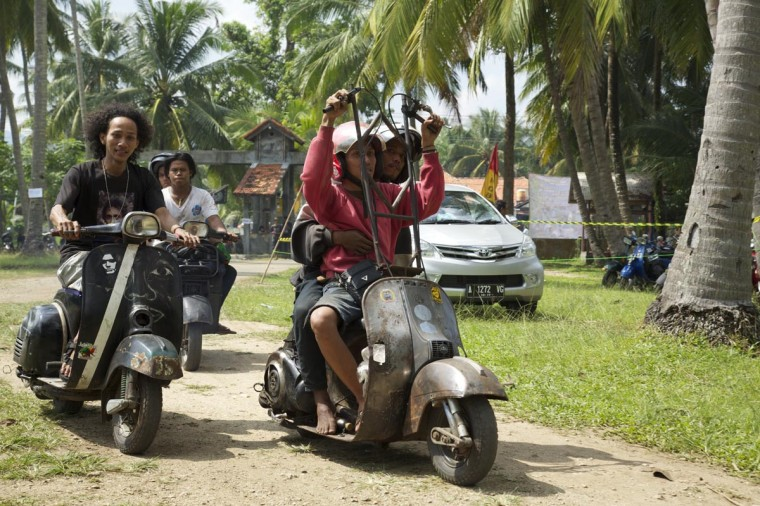 Vespa enthusiasts arrive for a scooter festival on June 30, 2013 in Cibeureum, about 100 km west of Jakarta, Indonesia. (Ed Wray/Getty Images)