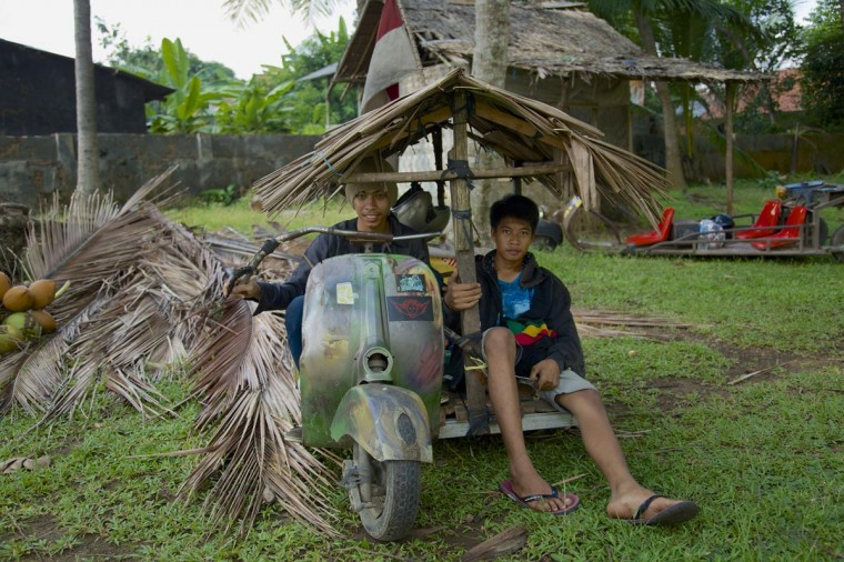 Windu (L) and Arief sit in their extreme vespa modification during a scooter festival on June 30, 2013 in Cibeureum, about 100 km west of Jakarta, Indonesia. (Ed Wray/Getty Images)