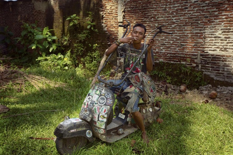 Iwan sits in his extreme vespa modification during a scooter festival on June 30, 2013 in Cibeureum, about 100 km west of Jakarta, Indonesia. (Ed Wray/Getty Images)