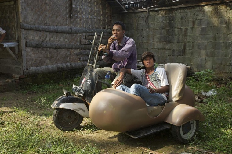 Zainal (L) and Cecep sit in their extreme vespa modification during a scooter festival on June 30, 2013 in Cibeureum, about 100 km west of Jakarta, Indonesia. (Ed Wray/Getty Images)