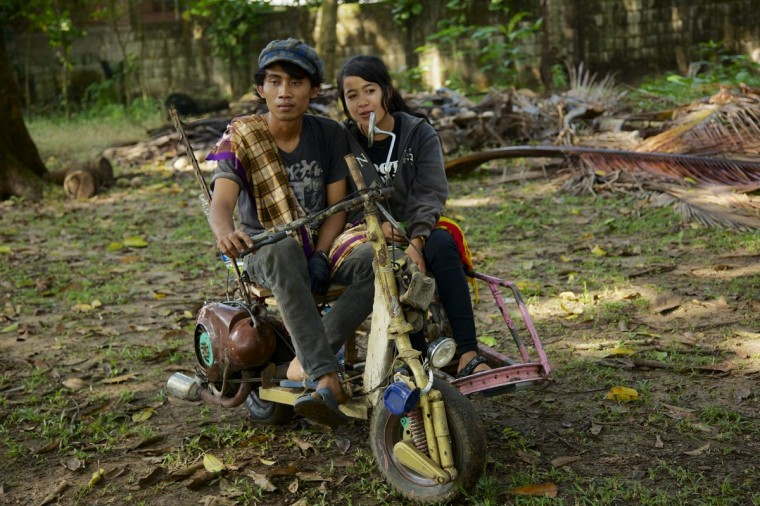 Alai and Rina sit in their extreme vespa modification during a scooter festival on June 30, 2013 in Cibeureum, about 100 km west of Jakarta, Indonesia. (Ed Wray/Getty Images)