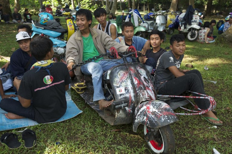 Vespa enthusiasts sit on their extreme Vespa modification during a scooter festival on June 30, 2013 in Cibeureum, about 100 km west of Jakarta, Indonesia. (Ed Wray/Getty Images)