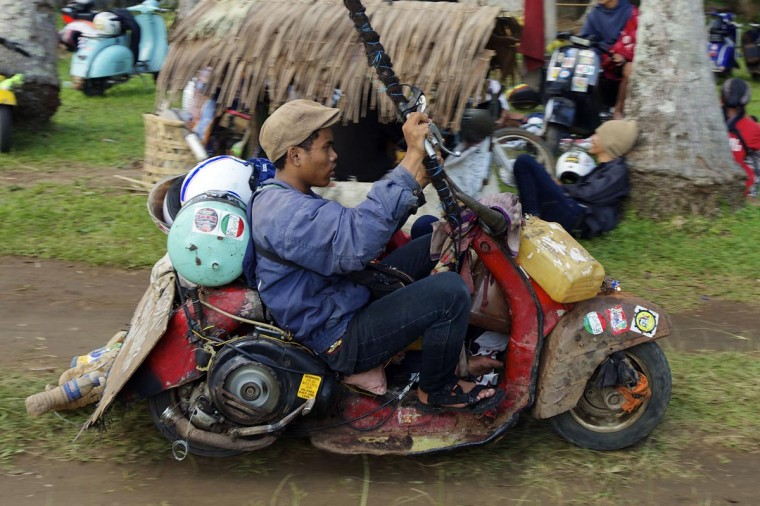 A Vespa enthusiast arrives at a scooter festival in his extreme Vespa modification on June 30, 2013 in Cibeureum, about 100 km west of Jakarta, Indonesia. (Ed Wray/Getty Images)