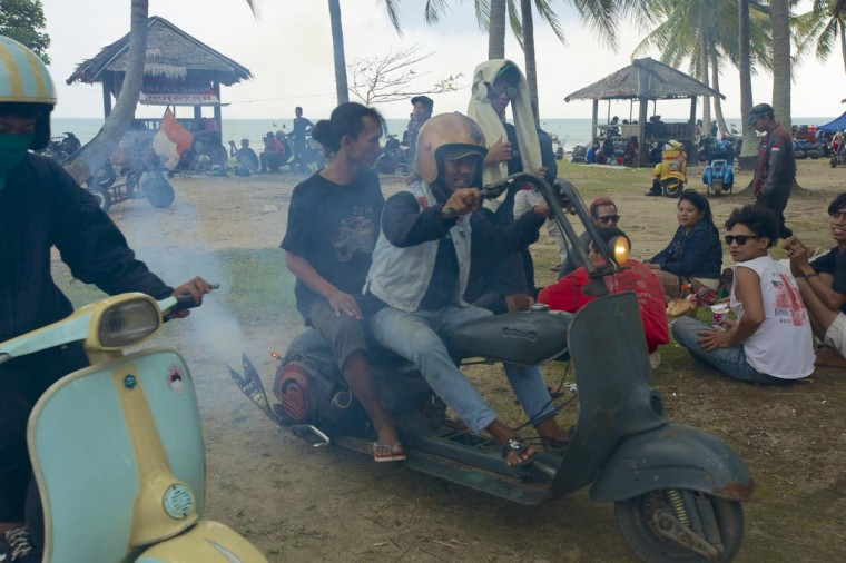Vespa owners head home on their extremely modified vespas after a scooter festival on June 30, 2013 in Cibeureum, about 100 km west of Jakarta, Indonesia. (Ed Wray/Getty Images)