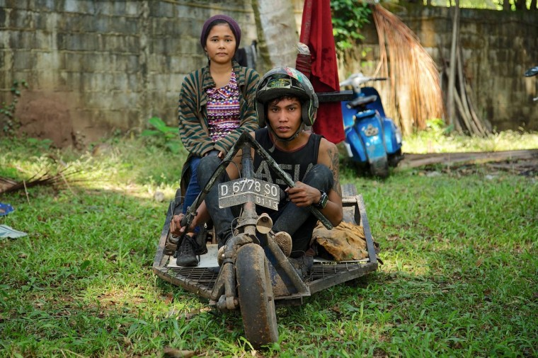 Dede and Anna sit in their extreme vespa modification during a scooter festival on June 30, 2013 in Cibeureum, about 100 km west of Jakarta, Indonesia. (Ed Wray/Getty Images)