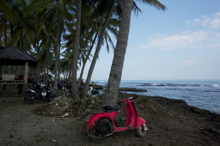 A brightly painted Vespa is parked on the beach during a scooter festival on June 30, 2013 in Cibeureum, about 100 km west of Jakarta, Indonesia. (Ed Wray/Getty Images)