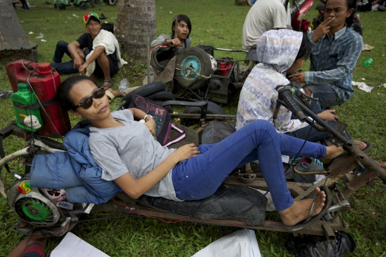 A Vespa enthusiast sits on her extreme Vespa modification during a scooter festival on June 30, 2013 in Cibeureum, about 100 km west of Jakarta, Indonesia. (Ed Wray/Getty Images)