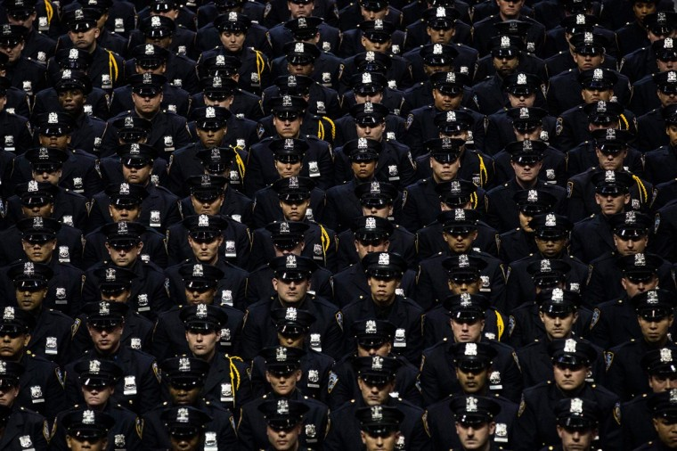 Some 781 New York City Police Academy cadets attend their graduation ceremony at the Barclays Center on July 2, 2013 in the Brooklyn borough of New York City. (Andrew Burton/Getty Images)