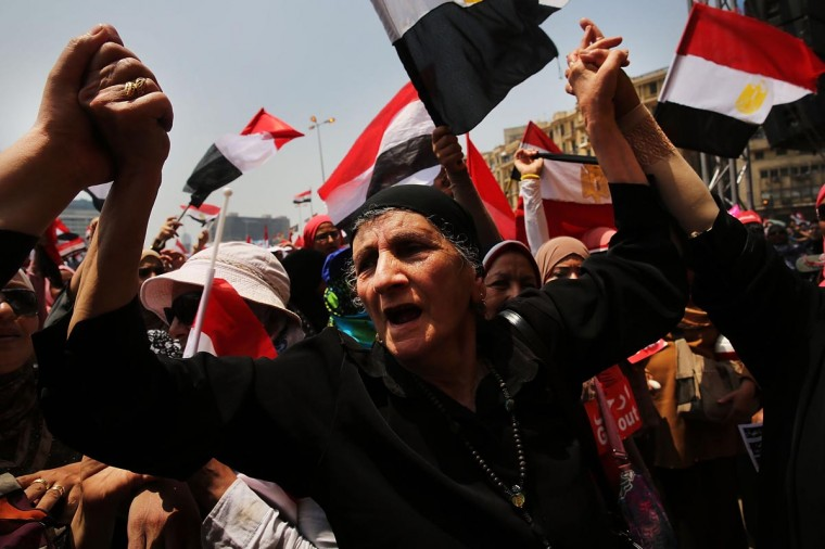 Hundreds of Egyptian protesters begin to gather in Tahrir Square as the deadline given by the military to Egyptian President Mohammed Morsi approaches on July 3, 2013 in Cairo, Egypt. As unrest spreads throughout the country, at least 23 people were killed in Cairo on Tuesday and over 200 others were injured. (Spencer Platt/Getty Images)