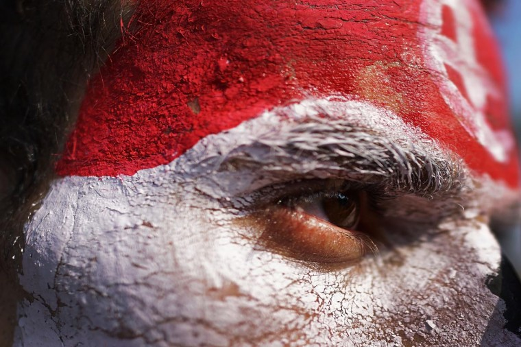 A man with his face painted the colors of the Egyptian flag looks out as thousands of Egyptian protesters celebrate in Tahrir Square as the deadline given by the military to Egyptian President Mohammed Morsi passes on July 3, 2013 in Cairo, Egypt. (Spencer Platt/Getty Images)