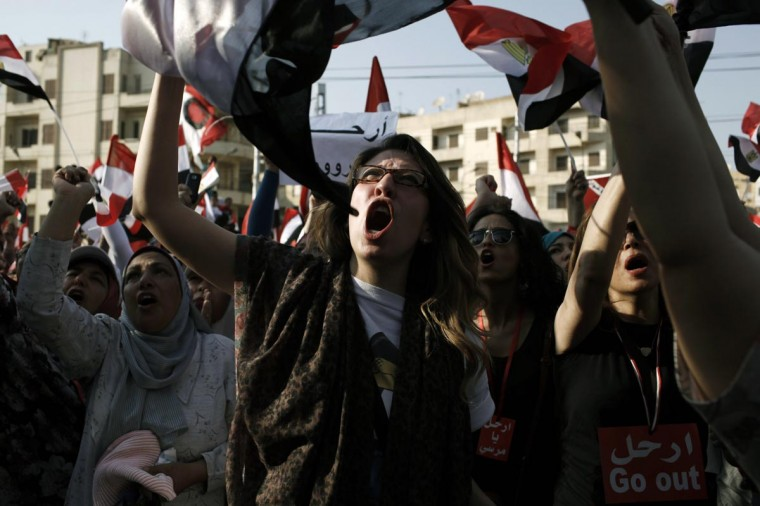 Egyptian opposition protesters celebrate as news is announced of Egyptian President Mohammed Morsi proposing a consensus government as a way out of the country's political crisis, at Egypt's Presidential Palace on July 3, 2013 in Cairo, Egypt. (Ed Giles/Getty Images)