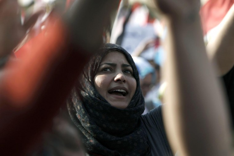 Egyptian opposition protesters take part in a demonstration as the deadline given by the military to Egyptian President Mohammed Morsi approaches, at Egypt's Presidential Palace on July 3, 2013 in Cairo, Egypt. (Ed Giles/Getty Images)