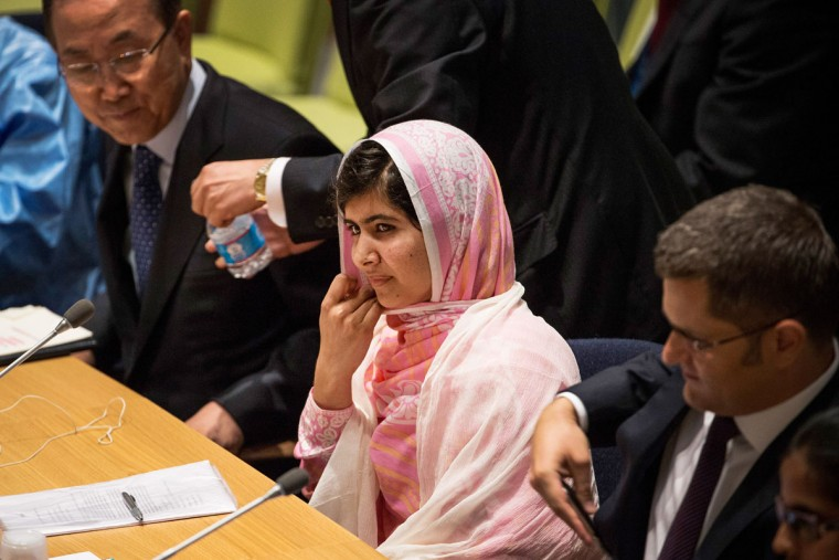 "Malala Yousafzai, the 16-year-old Pakistani advocate for girls' education who was shot in the head by the Taliban, sits before speaking at the United Nations (UN) Youth Assembly on July 12, 2013 in New York City. The United Nations declared July 12, ""Malala Day."" Yousafzai also celebrates her birthday today. (Andrew Burton/Getty Images)"