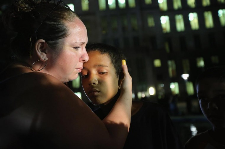 Melinda O'Neal (L) breaks into tears and hugs Shedrick Burfect in front of the Seminole County Criminal Justice Center after learning George Zimmerman had been found not guilty in the Murder of Trayvon Martin on July 13, 2013 in Sanford, Florida. Zimmerman, a neighborhood watch volunteer, shot and killed 17-year-old Martin after an altercation in February 2012. (Photo by Scott Olson/Getty Images)