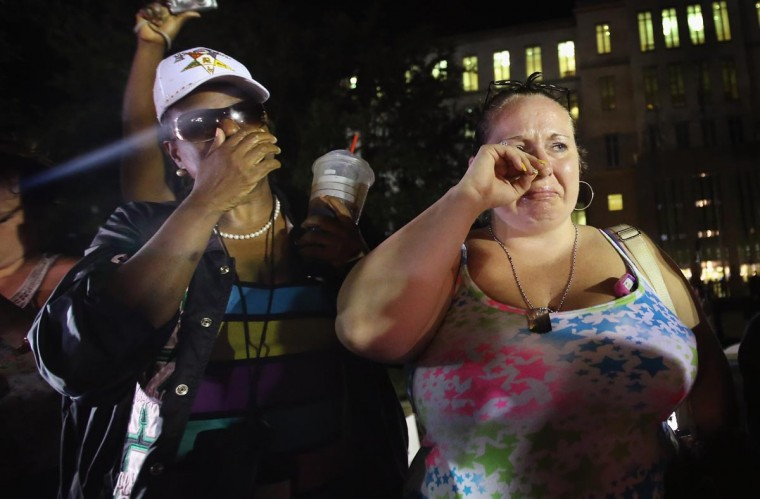 Kat Crowe (L) and Melinda O'Neal react in front of the Seminole County Criminal Justice Center after learning George Zimmerman had been found not guilty in the Murder of Trayvon Martin on July 13, 2013 in Sanford, Florida. (Scott Olson/Getty Images)