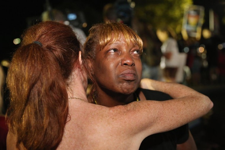 Tanetta Foster is comforted by Erika Rodgers (L) after she breaks into tears in front of the Seminole County Criminal Justice Center after learning George Zimmerman had been found not guilty in the Murder of Trayvon Martin on July 13, 2013 in Sanford, Florida. (Scott Olson/Getty Images)