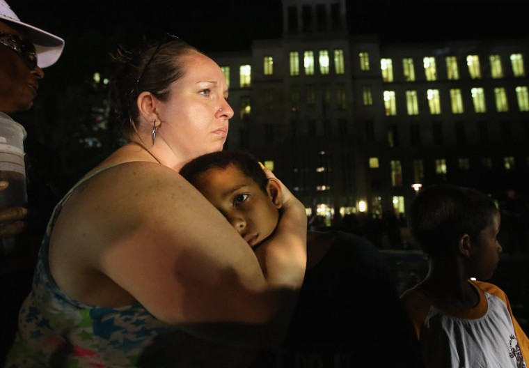 Melinda O'Neal (L) breaks into tears and hugs Shedrick Burfect in front of the Seminole County Criminal Justice Center after learning George Zimmerman had been found not guilty in the Murder of Trayvon Martin on July 13, 2013 in Sanford, Florida. (Scott Olson/Getty Images)