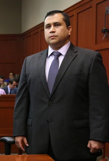 George Zimmerman listens as the verdict is announced that the jury finds him not guilty, on the 25th day of his trial at the Seminole County Criminal Justice Center July 13, 2013 in Sanford, Florida. Zimmerman was charged with second-degree murder in the 2012 shooting death of Trayvon Martin. (Joe Burbank/Getty Images)