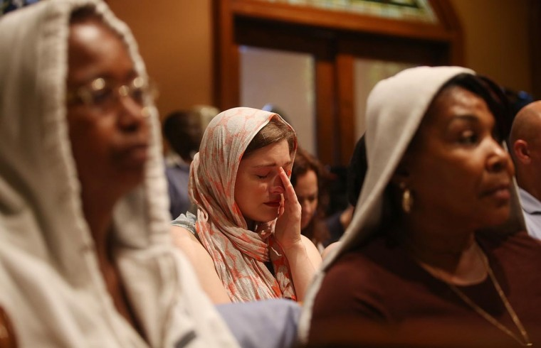 People sit during services honoring Trayvon Martin at Middle Collegiate Church in Manhattan on July 14, 2013 in New York City. George Zimmerman was acquitted of all charges in the shooting death of Martin July 13 and some congregants wore hoodies during the service to honor Martin. (Mario Tama/Getty Images)