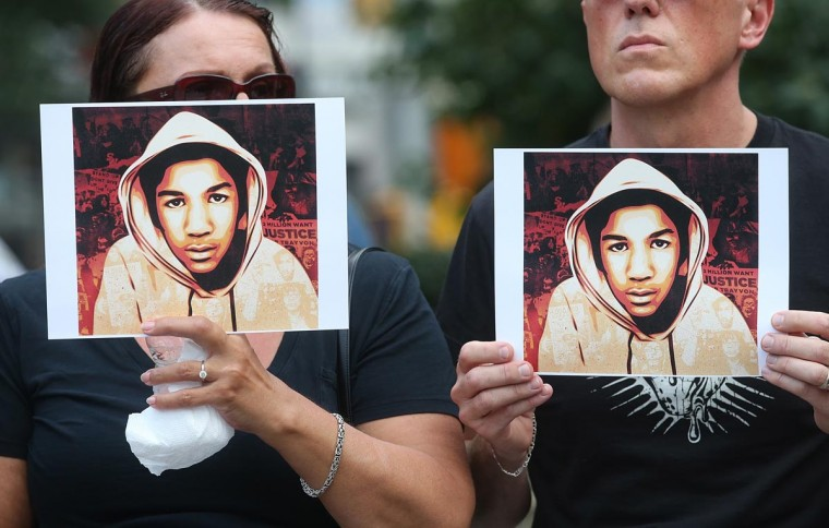 People hold photos of Trayvon Martin at a rally honoring Martin at Union Square in Manhattan on July 14, 2013 in New York City. (Mario Tama/Getty Images)