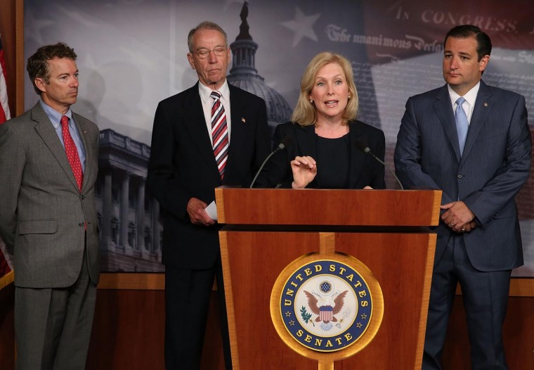 U.S. Sen. Kirsten Gillibrand (D-NY) (C) speaks while flanked by U.S. Sen. Rand Paul (R-KY) (L), and U.S. Sen. Charles Grassley (R-IA) (2nd-L) and U.S. Sen. Ted Cruz (R-TX) during a news conference on sexual assault in the military, July 16, 2013 in Washington, DC. Gillibrand announced the support of 34 senators that will co-sponsor her proposal to take the decision whether to prosecute sexual assaults out of the hands of the military chain of command. (Mark Wilson/Getty Images)