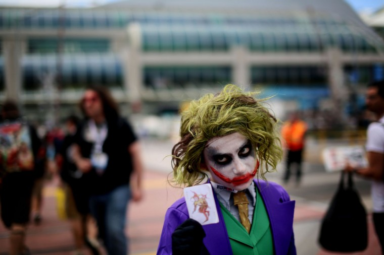 Michaell Cherry shows his Joker costume during Comic Con at the San Diego Convention Center on July 19, 2013 in San Diego, California. Comic Con International Convention is the world's largest comic and entertainment event and hosts celebrity movie panels, a trade floor with comic book, science fiction and action film-related booths, as well as artist workshops and movie premieres. (Sandy Huffaker/Getty Images)