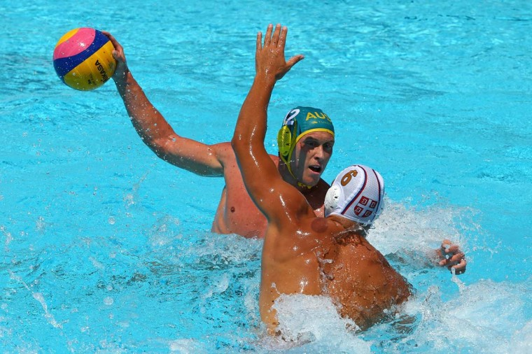 William Miler of Australia looks to pass against Dusko Pijetlovic of Serbia during the Men's Water Polo first preliminary round match between Serbia and Australia during day three of the 15th FINA World Championships at Piscines Bernat Picornell on July 22, 2013 in Barcelona, Spain. (Al Bello/Getty Images)