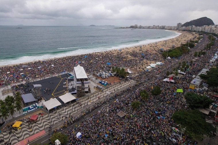 People gather at Copacabana beach to hear Pope Francis celebrate mass on July 25, 2013 in Rio de Janeiro, Brazil. More than 1.5 million pilgrims are expected to join the Pope for his visit to the Catholic Church's World Youth Day celebrations. (Buda Mendes/Getty Images)