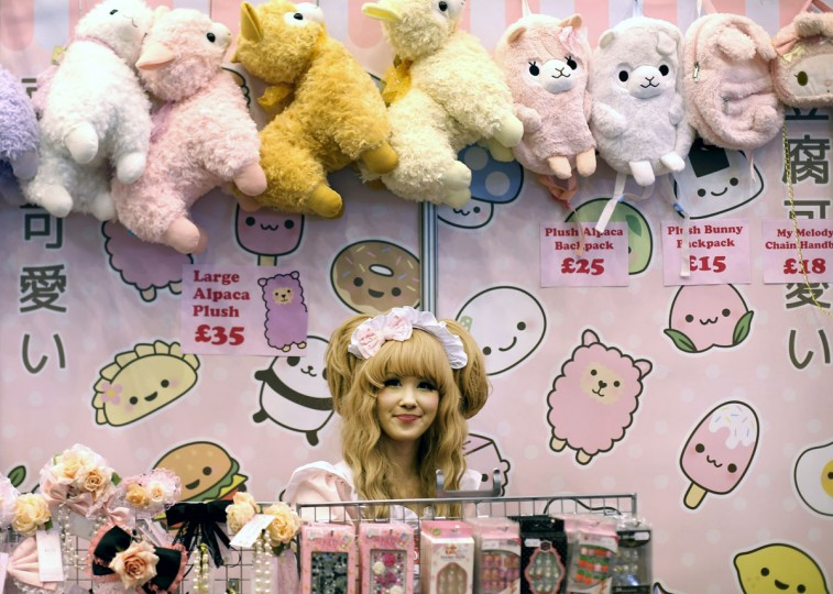 A stall holder in costume waits for customers at the Hyper Japan event at Earls Court on July 26, 2013 in London, England. The show is the UK's biggest Japanese culture event, with stalls selling clothing and artwork. Live music, Japanese food and computer gaming areas are also on show. Many attendees dress up as anime characters or in the lolita fashion widespread in Japan. (Peter Macdiarmid/Getty Images)