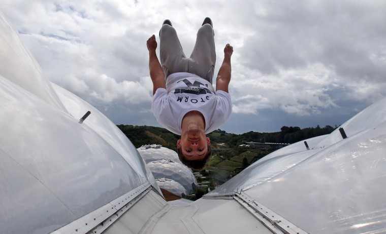 Pip Andersen, professional free-runner and parkour expert, somersaults on the roof of the Eden's Rainforest Biome on July 29, 2013 in St Austell, England. Andersen and Tim Shieff who are both members of Storm Freerun, were at the Eden Project to help make a promotional video for the Cornish attraction. (Matt Cardy/Getty Images)