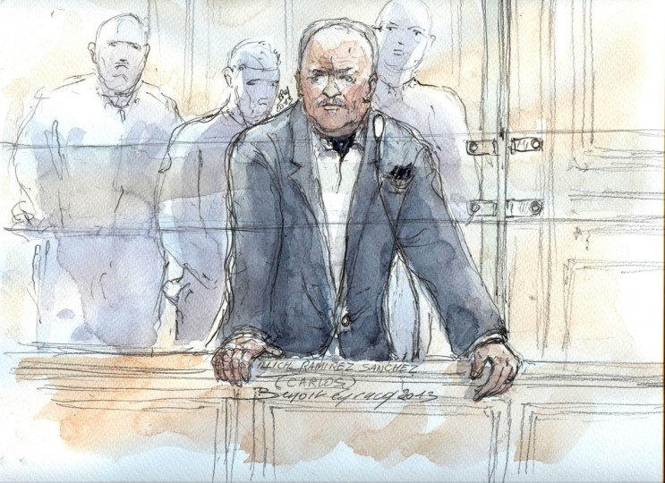 This court sketch made on May 13, 2013 at the Paris courthouse shows notorious Venezuelan militant Carlos the Jackal at the opening of his appeal trial for a series of deadly bombings in France 30 years ago. The trial kicked off with Carlos, whose real name is Ilich Ramirez Sanchez, appearing without his defense lawyers and saying he had asked them not to attend. The 63-year-old, who has been imprisoned in France since his capture in Sudan in 1994, was found guilty in 2011 of masterminding the 1982 and 1983 attacks on two French passenger trains, a train station in Marseille and a Libyan magazine office in Paris. (Benoit Peyrucq/AFP/Getty Images)