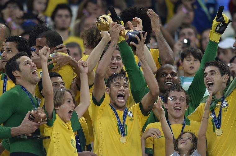 Brazil's forward Neymar (C) celebrates with the trophy of the FIFA Confederations Cup Brazil 2013, at the Maracana Stadium in Rio de Janeiro on June 30, 2013. Brazil won the title after defeating Spain 3-0 in the final of the football tournament. (Lluis Gene/AFP/Getty Images)