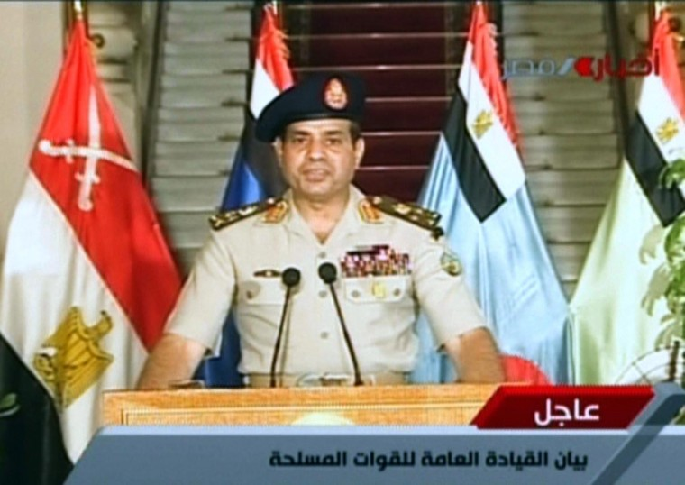 """An image grab taken from Egyptian state TV shows Egyptian Defense Minister Abdelfatah al-Sissi delivering a statement on July 3, 2013 as the army unveils a roadmap for Egypt's political future, with state media reporting that the plan sets a tight schedule for new elections. A top aide to Egypt's President Mohamed Morsi slammed what he called a """"military coup"""" as an army ultimatum passed and the security forces slapped a travel ban on the Islamist leader. (AFP/Getty Images)"""
