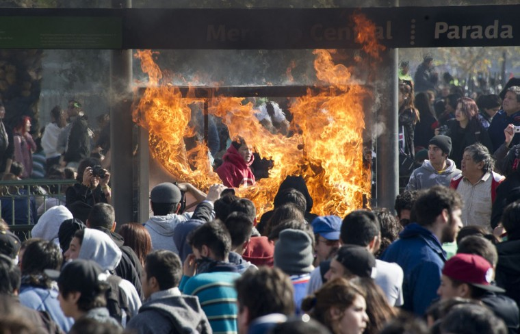 Demonstrators set on fire a bus stop during a national strike called by the Workers' United Center of Chile (CUT) against the government of President Sebastian Pinera, in Santiago on July 11,2013. (Martin Bernetti/AFP/Getty Images)