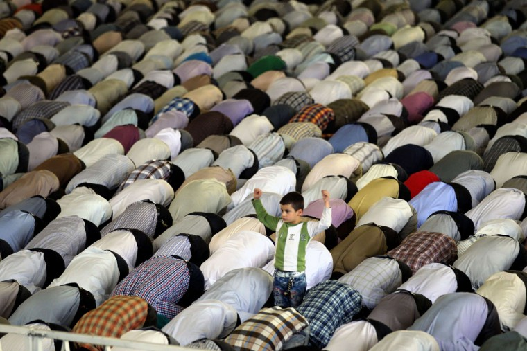 An young Iranian boy stands among Shiite Muslim worshipers attending the weekly Friday prayer during the Muslim fasting month of Ramadan on July 12, 2013 at the university of the Iranian capital, Tehran. During Ramadan, one of the five main religious obligations under Islam, Muslims are required to abstain from food and from drinking liquids, smoking and having sex from dawn until dusk. (Atta Kenare/AFP/Getty Images)