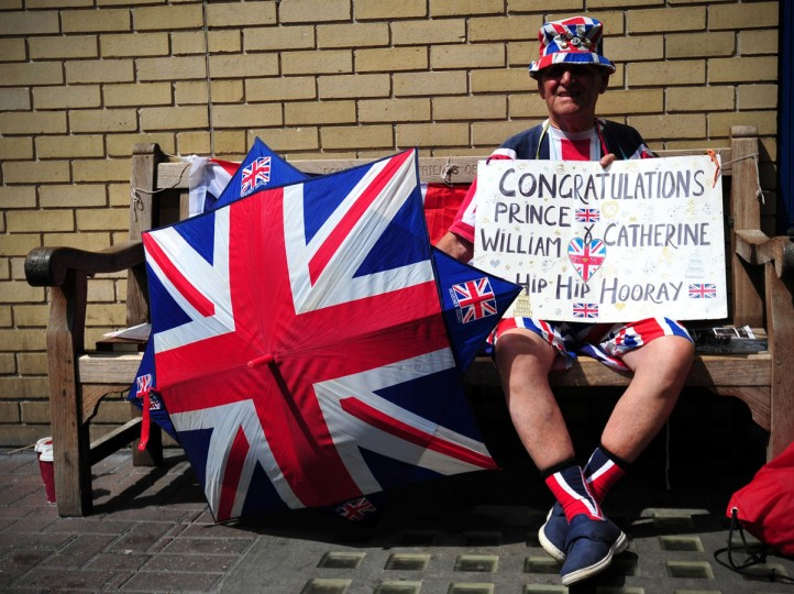 Royal well-wisher Terry Hutt poses for a picture as he waits outside the Lindo Wing of Saint Mary's Hospital in London, on July 12, 2013, where Prince William and his wife Catherine's baby will be born. Britain's royal family and the world's media are on tenterhooks awaiting the birth of Prince William and wife Catherine's first child, a baby who will one day be king or queen of Britain and a diverse group of commonwealth countries. (Carl Court/AFP/Getty Images)