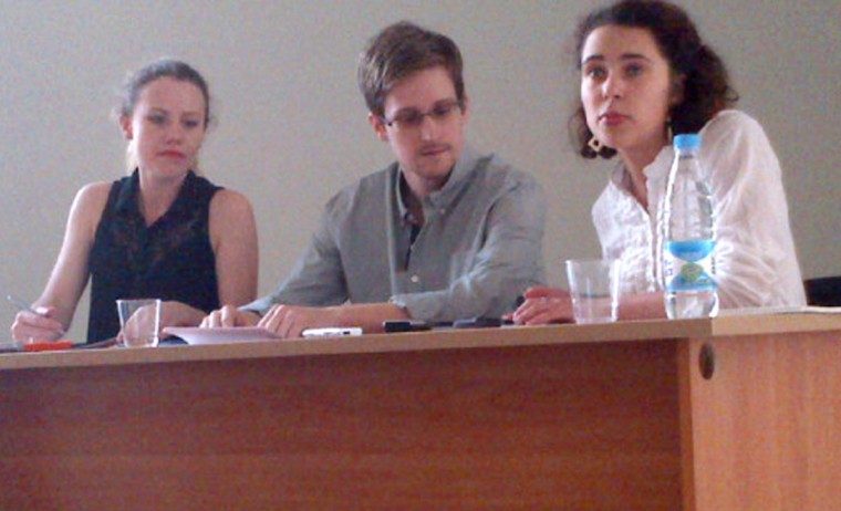 In this picture released by Human Rights Watch, U.S. fugitive and National Security Agency (NSA) leaker Edward Snowden (center) meets with rights activists at Moscow's Sheremetyevo airport, on July 12, 2013. Snowden told a group of activists that he wanted to claim asylum in Russia because he is unable to fly on anywhere else. (Tanya Lokshina/Human Rights Watch via AFP/Getty Images)