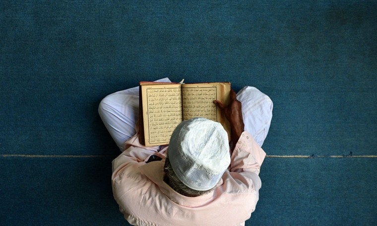 A Sri Lankan Muslim prays after breaking his fast at a mosque in Colombo on July 12, 2013. Islam's holy month of Ramadan is calculated on the sighting of the new moon, and Muslims all over the world are supposed to fast from dawn to dusk during the month. (Ishara S. Kodikara/AFP/Getty Images)